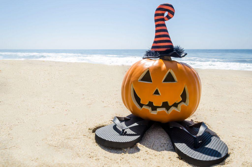 Happy Halloween Pumpkin on the Beach