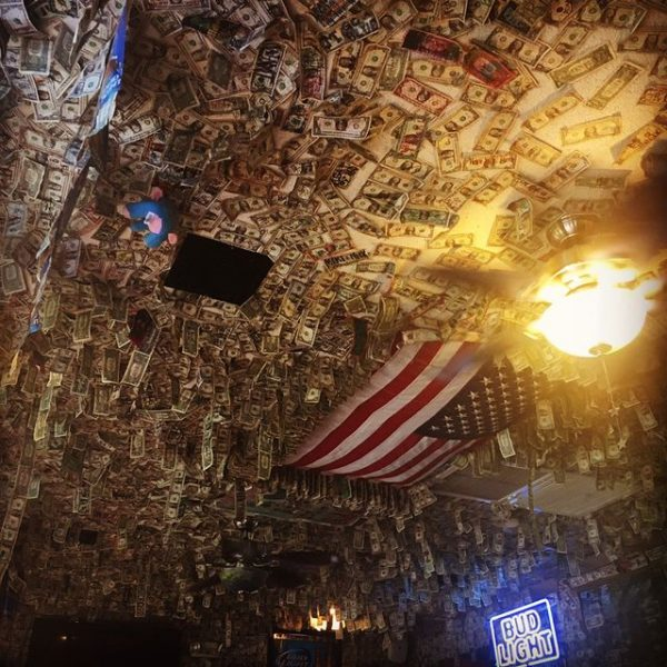 Dollar Bills covering the roof and walls at Dustys Oyster Bar PCB