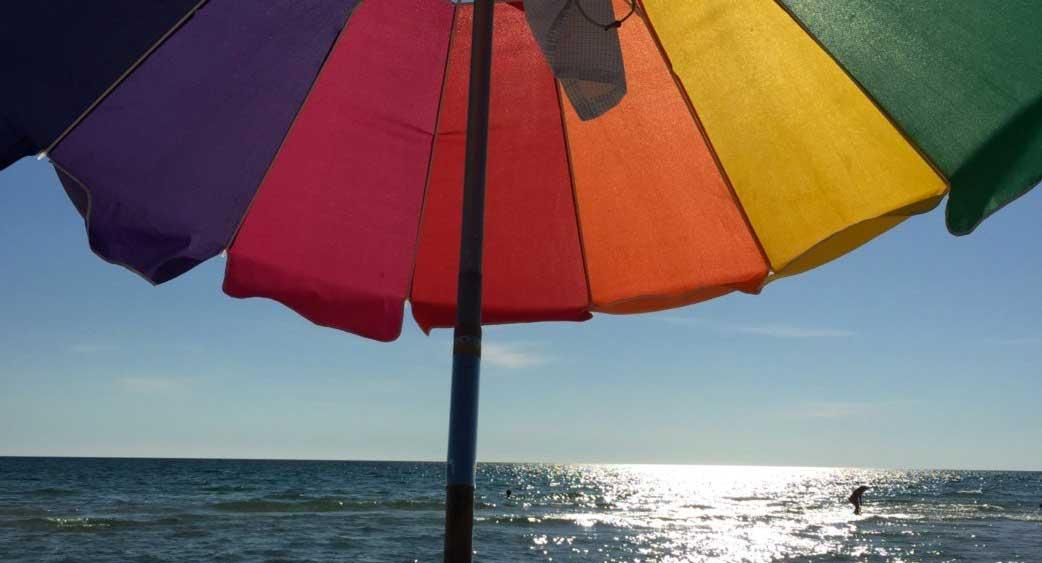 Rainbow Umbrella on the Beach